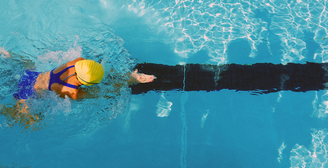 woman doing the breaststroke in a swimming pool