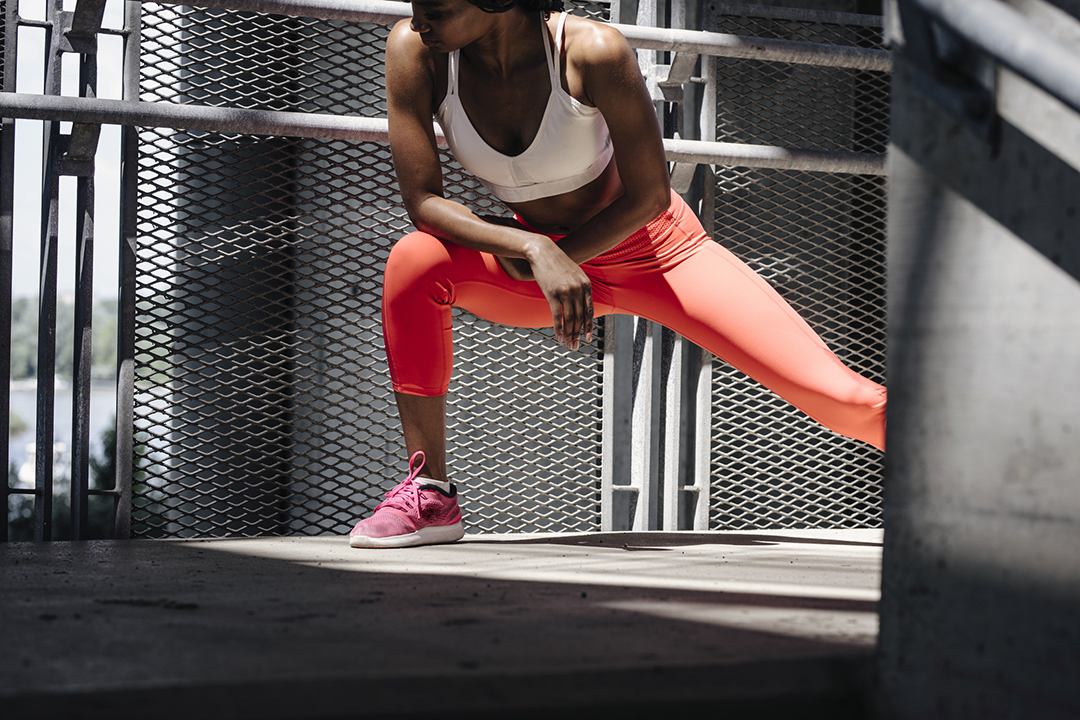 thigh exercises - woman doing side lunges