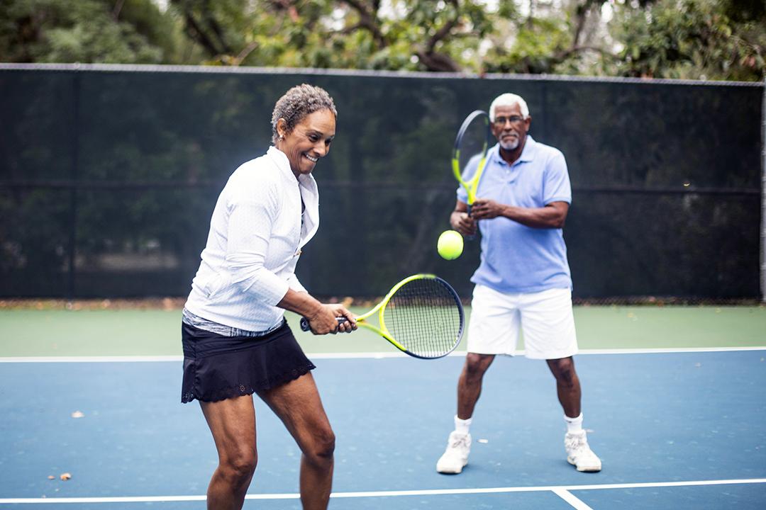 thigh exercises - senior couple playing tennis