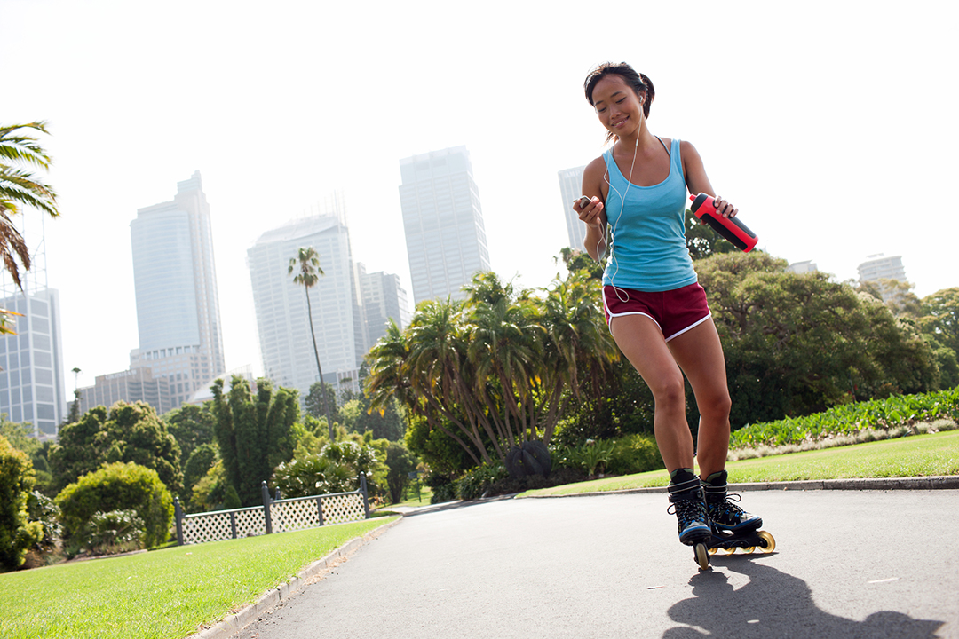 thigh exercises - woman rollerblading at a city park