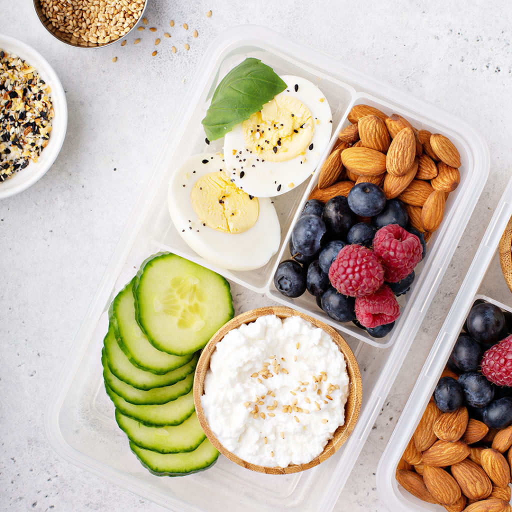 healthy snacks, Lunch or snack box with high protein food, cottage cheese, nuts and eggs
