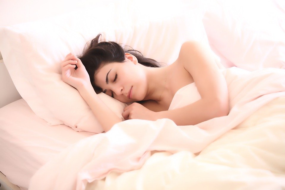 Young beautiful girl sleeps in the bedroom