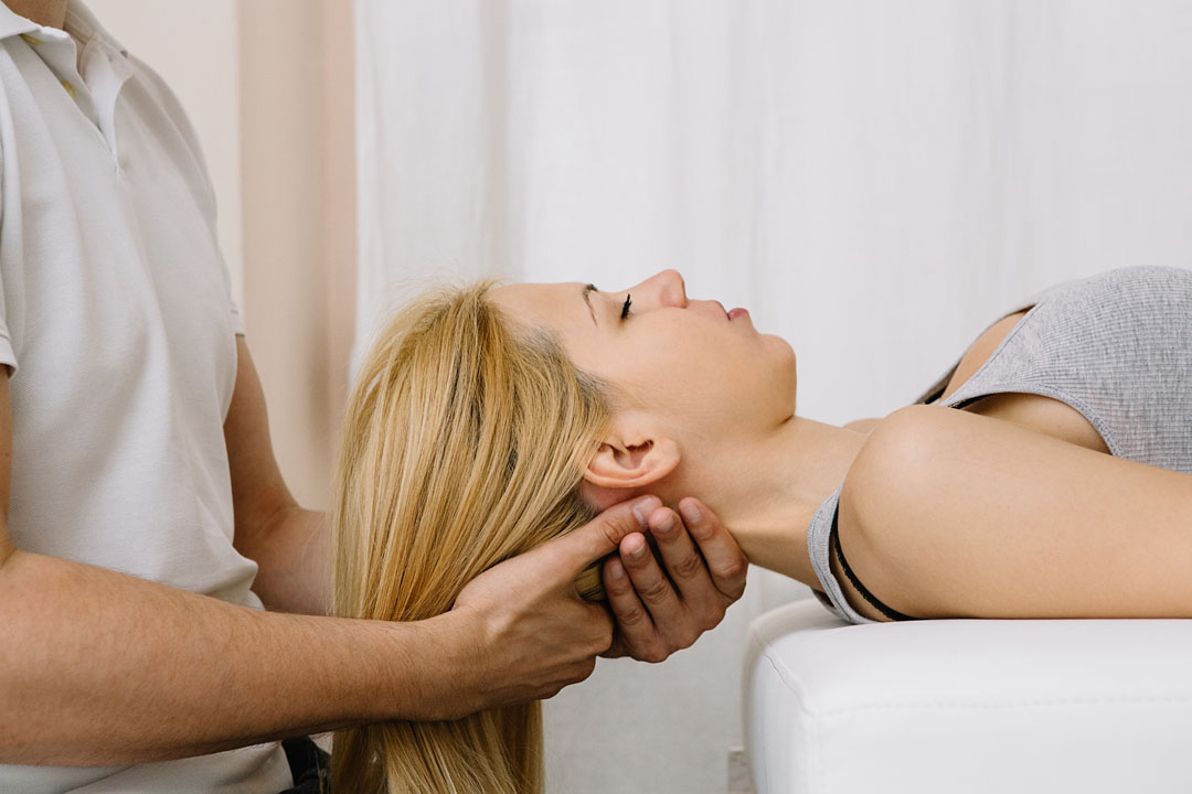 woman getting a chiropractic neck adjustment