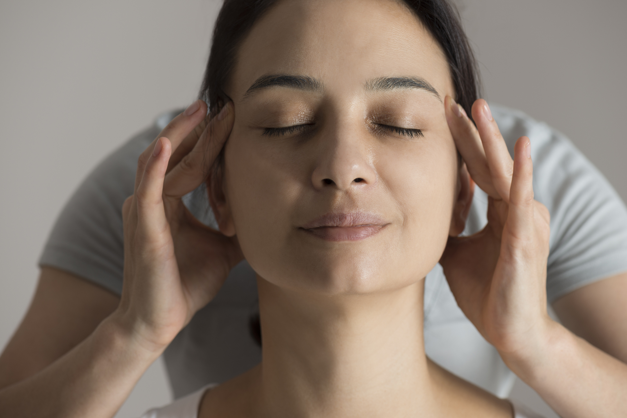 woman massaging away headache