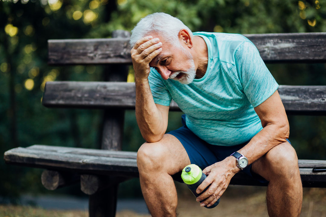senior man with a headache after exercising