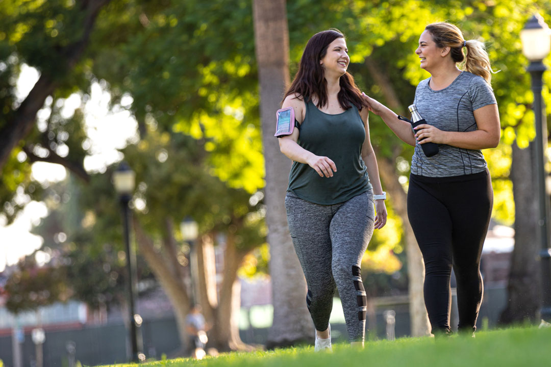 Young women jogging and getting healthy at the park