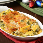 Butternut squash gratin with spinach and cheeses on a holiday table