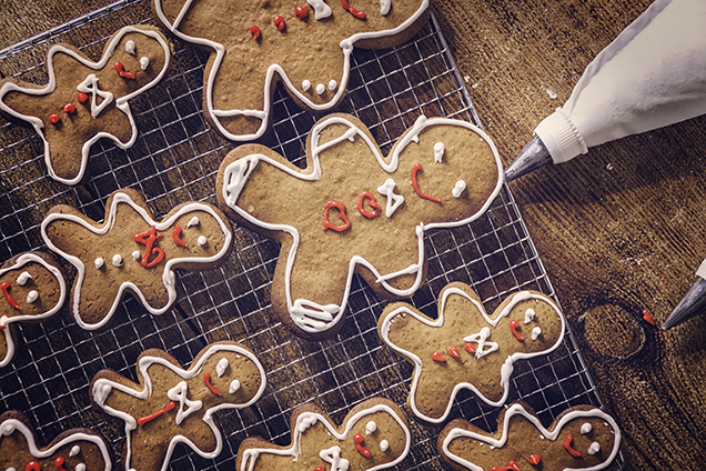 Decorating gingerbread Christmas Cookies with colorful icing