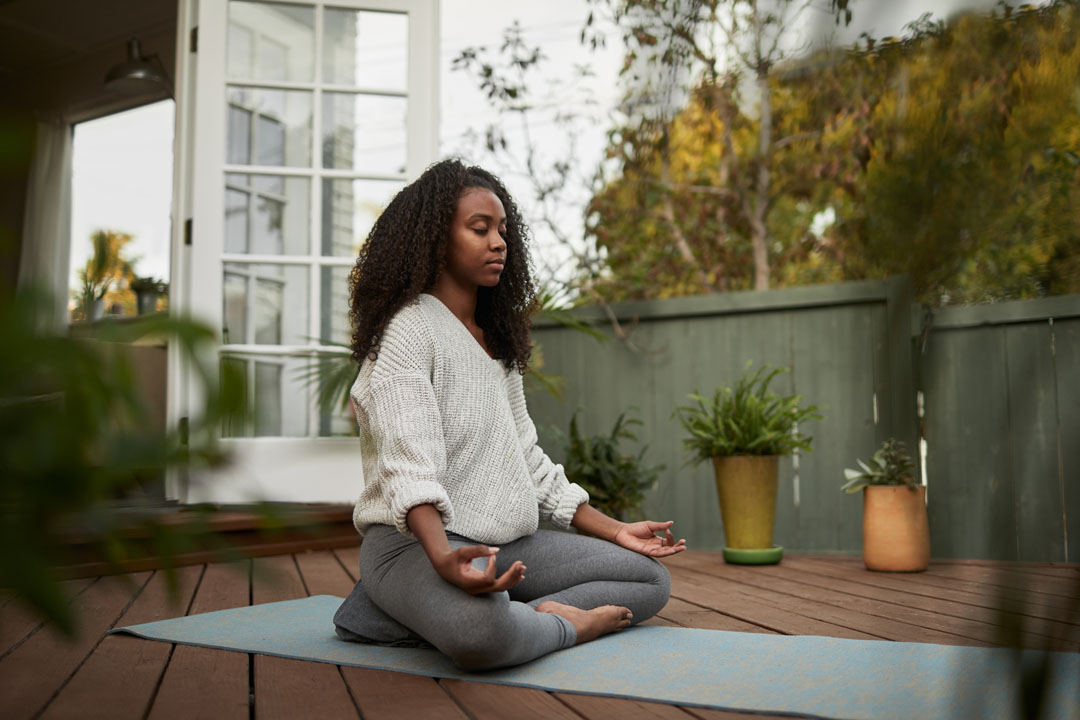woman destressing with meditation
