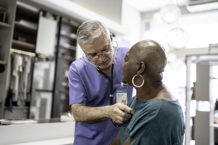 Doctor examining patient heart health