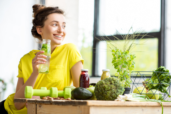 Woman with healthy food detox green smoothie
