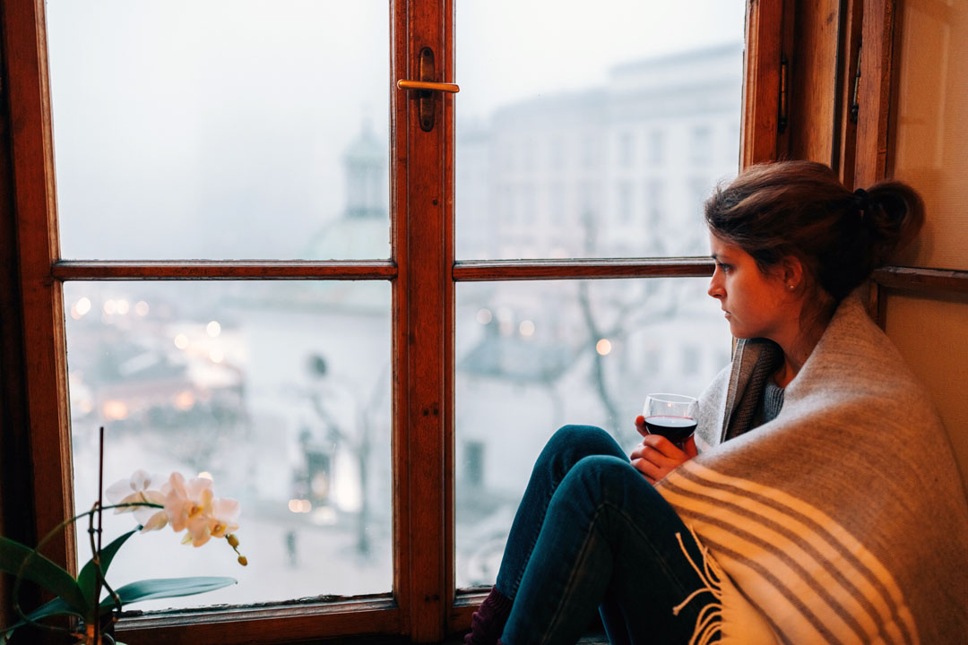 woman sitting by window - seasonal depression - gut health - alignlife
