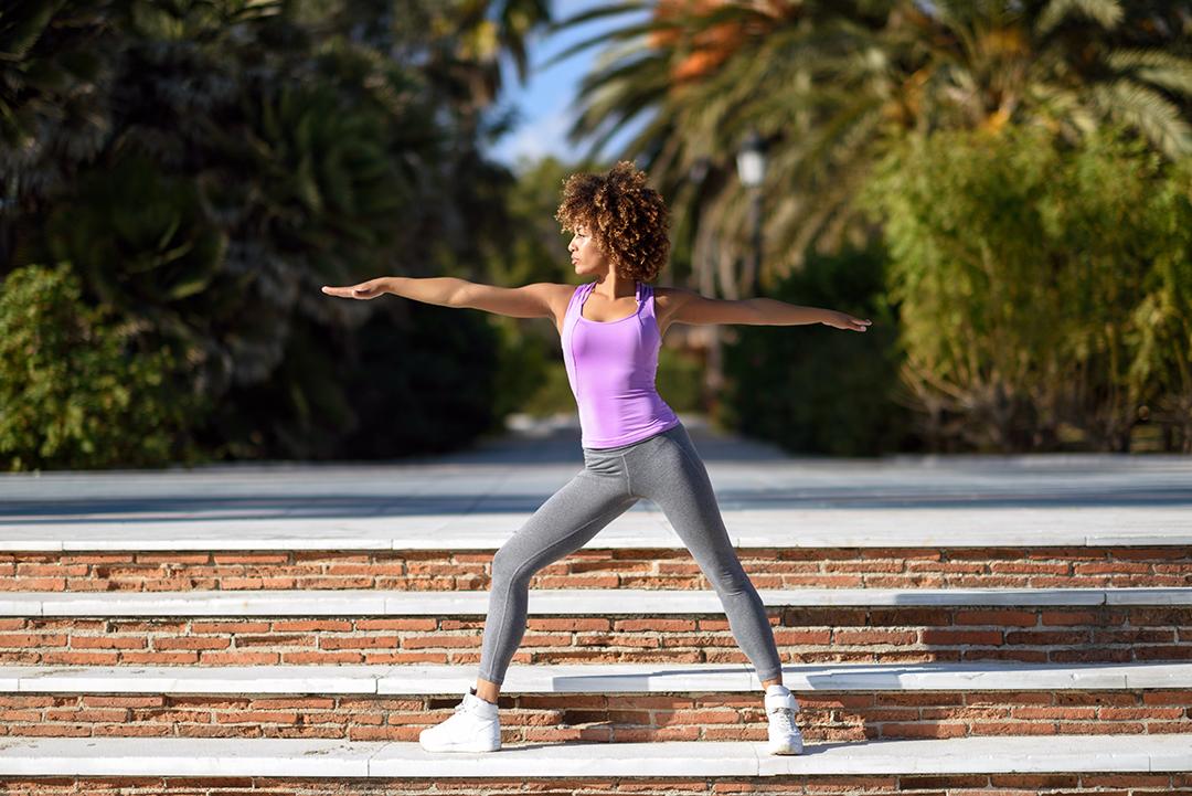 morning yoga - warrior pose - Black woman