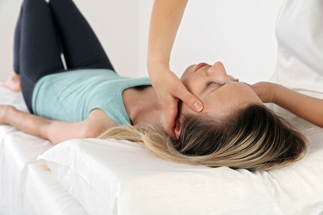 woman getting a chiropractic adjustment - seasonal spring allergy relief
