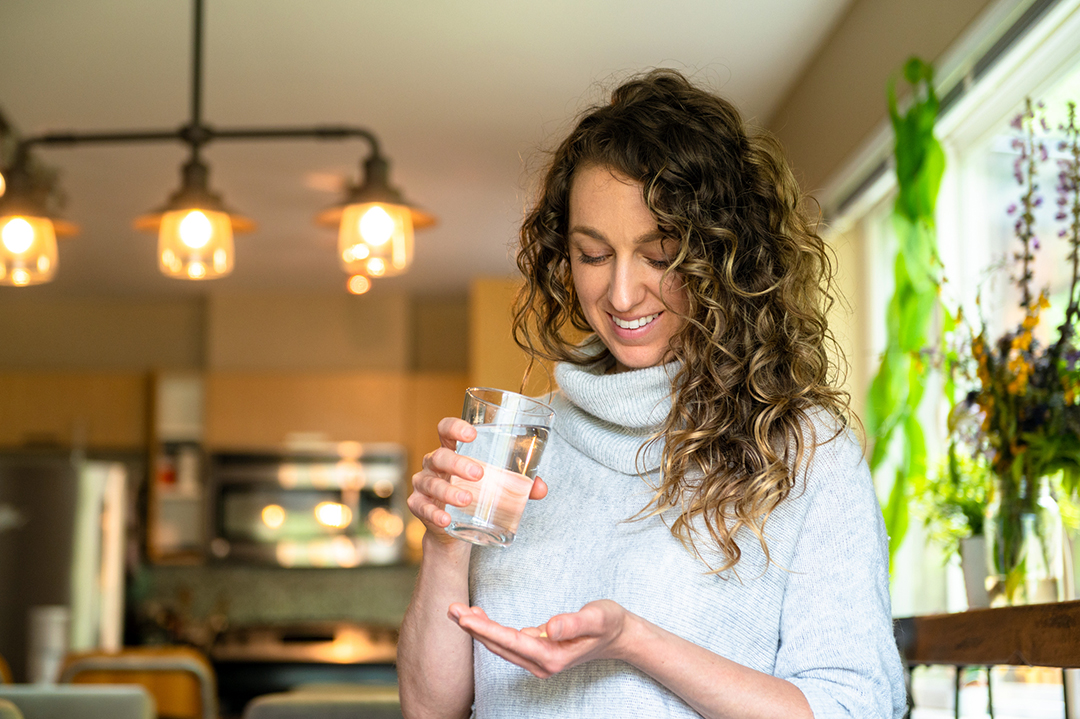 Woman taking daily supplements - allergy relief