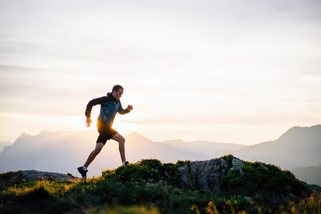 man running on mountain plateau - fitness exercise plateau - weightlifting