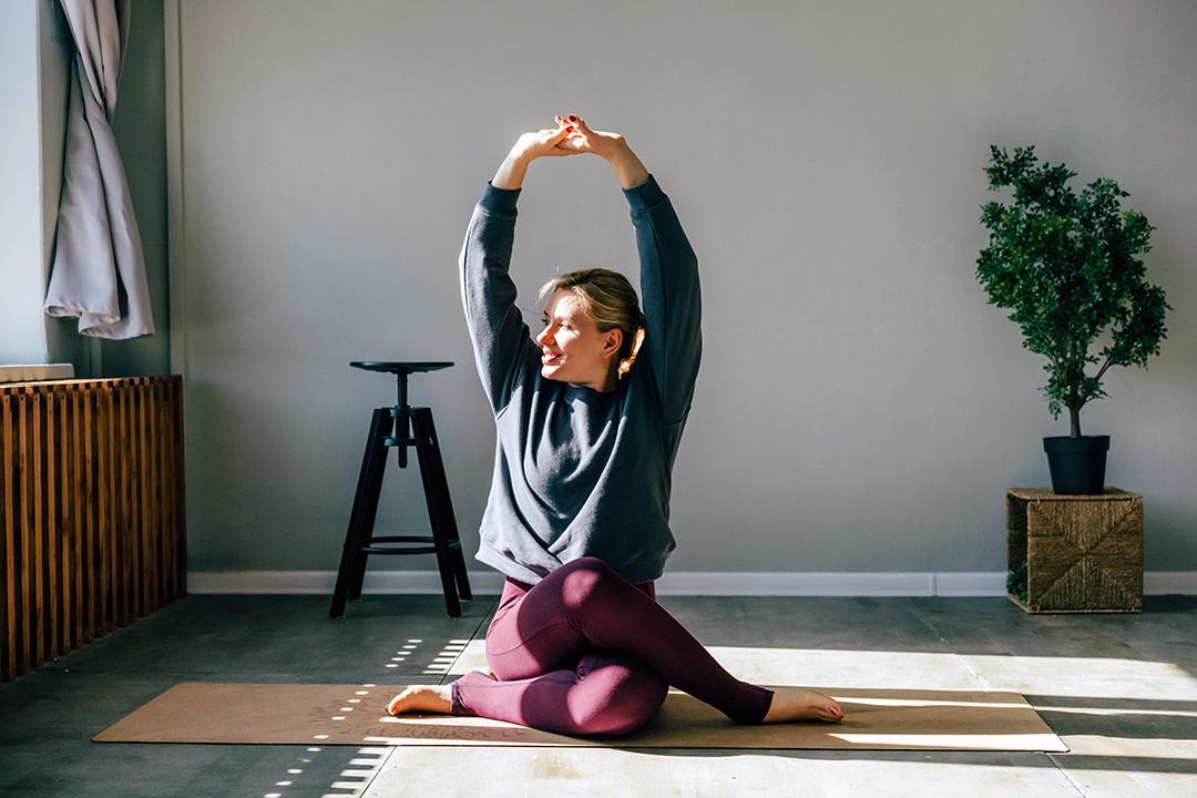 woman doing morning yoga sitting in the sun