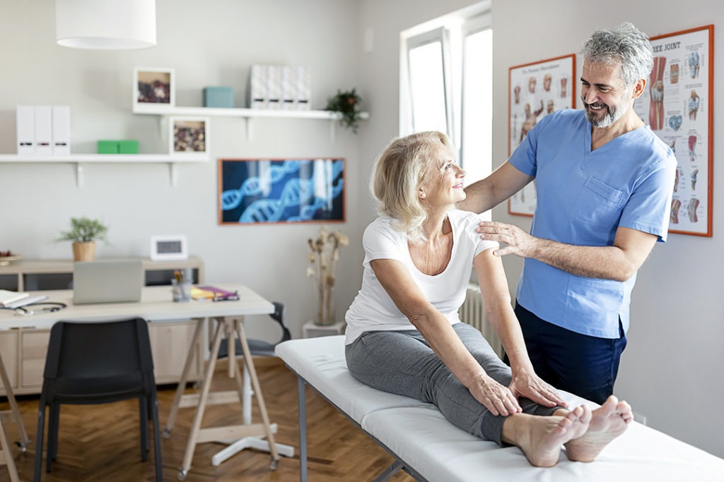 Chiropractor Examining Female Senior Patient - bone health - osteoporosis