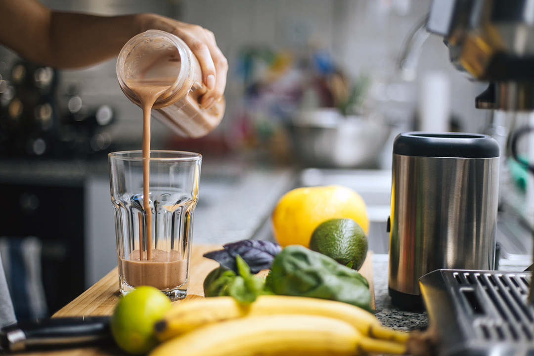healthy protein - Woman preparing fresh fruit smoothie