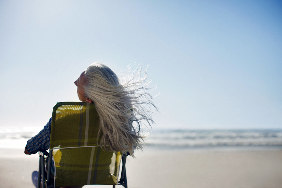 Womans hair blowing in wind on beach