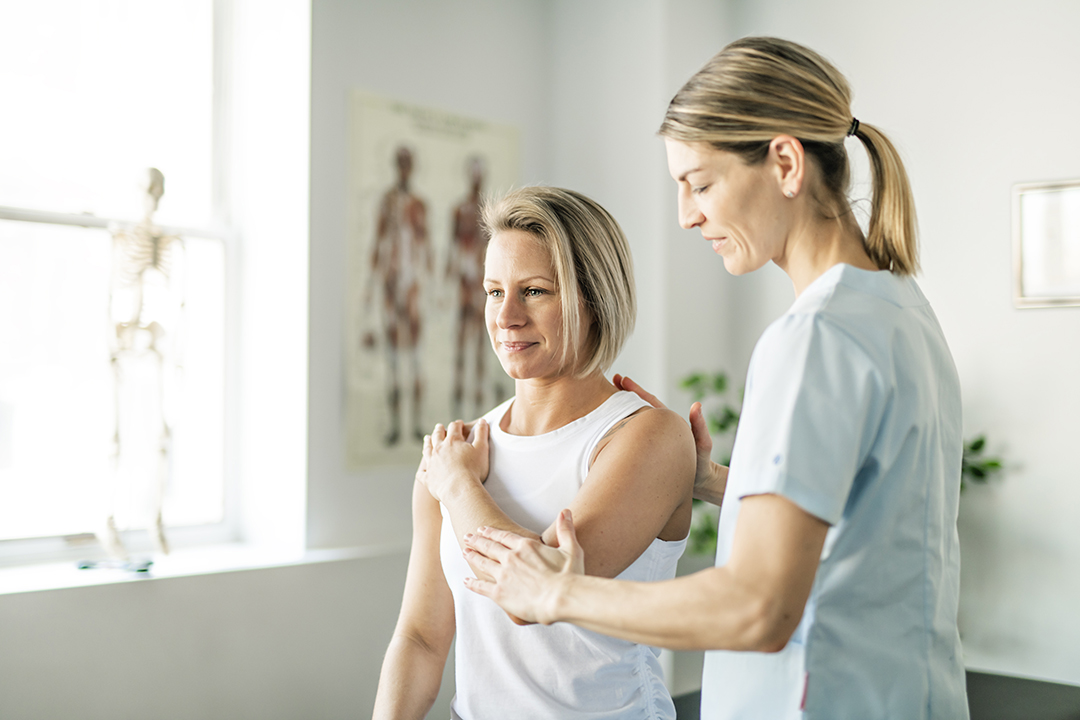 chiropractor checking range of motion - chiropractic myths busted