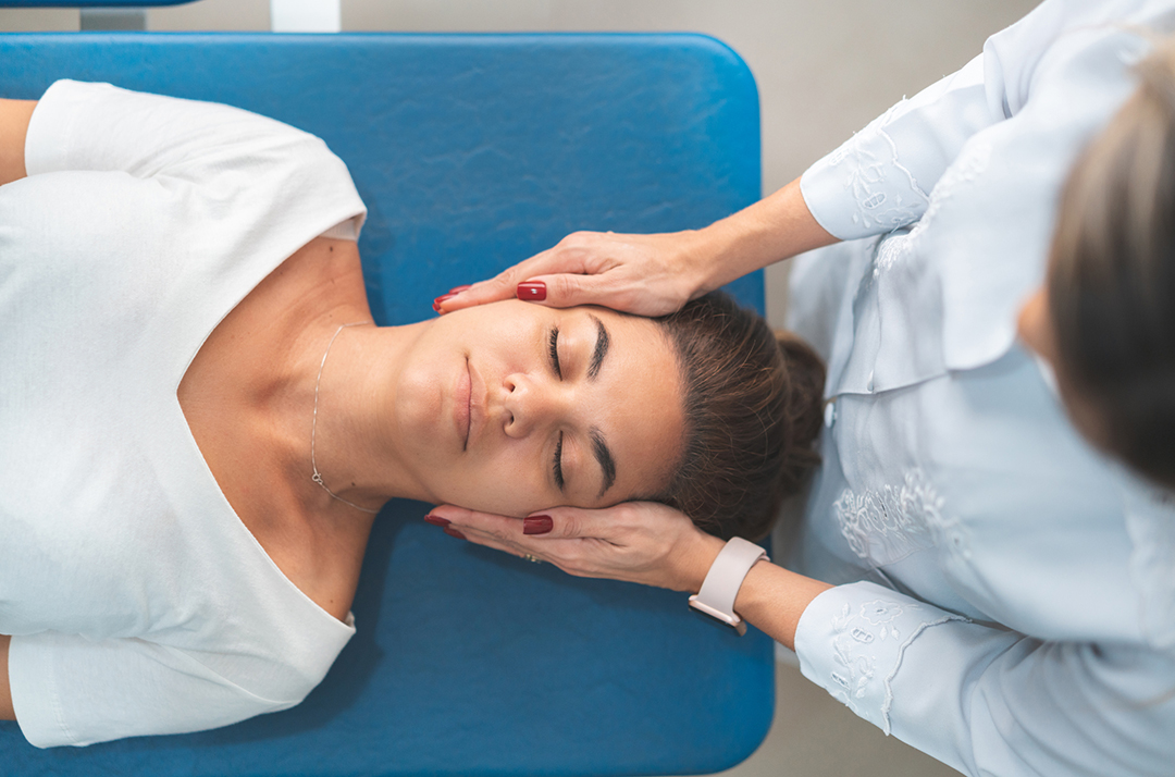 chiropractor checking woman's neck - chiropractic myths busted