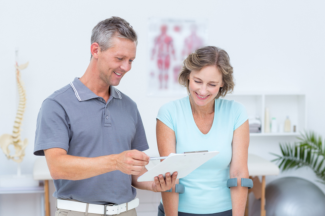 chiropractor going over care plan - chiropractic myths busted