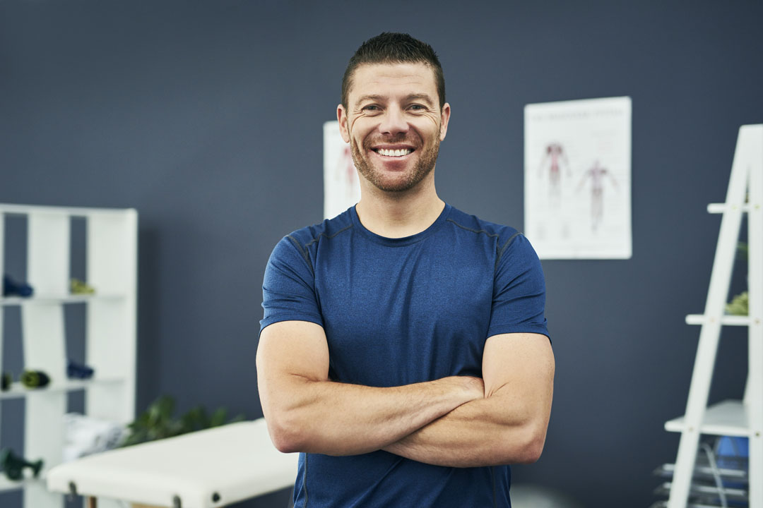chiropractor smiling - chiropractic myths busted