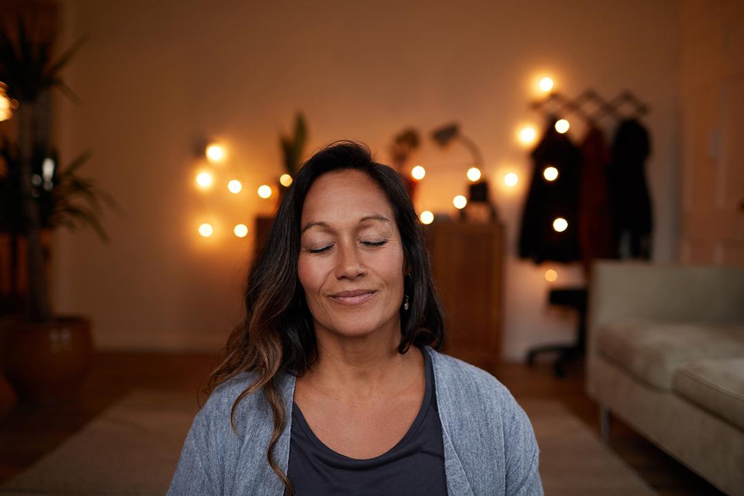 woman doing meditation exercises at night