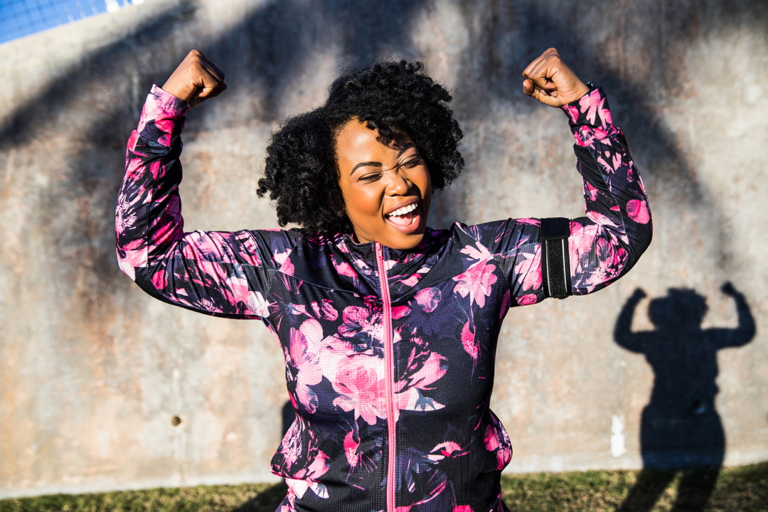 black woman excited and happy she was able to lose weight