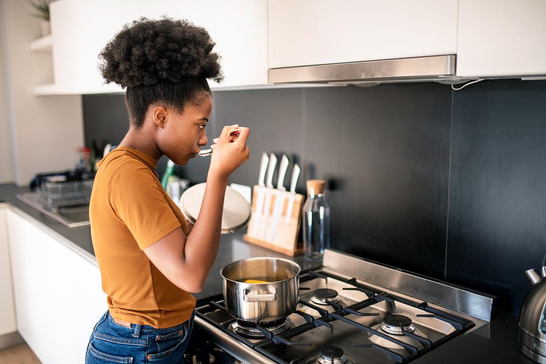 Young woman preparing bone broth